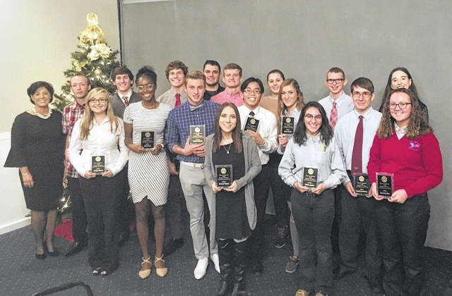 The Shawnee Optimists recently honored area seniors. Honorees included, from left to right, Chairman Cheryl Morgan, Shane Cornell, Ausdisty Brunk, Joseph Carver, Ayodele Ojo, Cooper Conley, Gabriel Williams, Kevin Miller, Louis Hoersten and Hannah Watson, and front, Wesley Nguyen, Jillella Weingart, Hailey Koenig, Maritza Aquirre, Samuel King, Daniel Siatkosky, Barbara Hayes and Cassandra Rose. Absent from the picture were Gracie Prine and Austin Dulebolm.