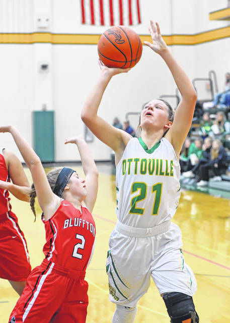 Ottoville's Nicole Knippen puts up a shot against Bluffton's Brinkley Garmatter during Saturday's game at Ottoville High School.