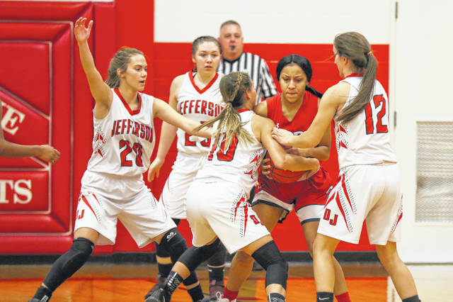 Perry's Makiah Denson gets swarmed by the defense of Delphos Jefferson on Wednesday night at Delphos Jefferson.