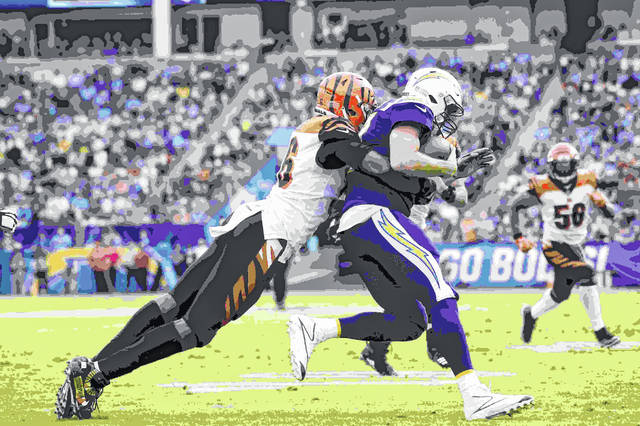 Los Angeles Chargers quarterback Philip Rivers, right, is sacked by Cincinnati Bengals defensive end Carlos Dunlap during the first half of an NFL football game Sunday, Dec. 9, 2018, in Carson, Calif. (AP Photo/Mark J. Terrill)