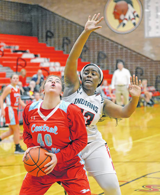 Shawnee's Kerri Roberson defends against Lima Central Catholic's Rosie Williams during Saturday's game at Shawnee High School.