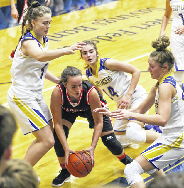 Lincolnview defenders surround Spencerville's Olivia Goecke as she attempts to make a pass during Thursday night's Northwest Conference game at Lincolnview. See more girls basketball photos at LimaScores.com.
