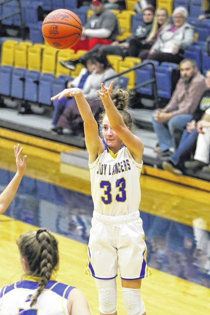 Lincolnview's Annie Mendenhall puts up a shot during Thursday night's Northwest Conference game at Lincolnview.