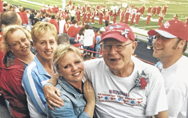 Stanley Sites loved watching Lima Central Catholic sporting events. Above, he is surrounded by his children at a LCC football game in which he was honored as senior of the game. He has his arm around daughter Susie. Daughters Betsy is behind Susie and Marty is behind Betsy. To the right is one of his grandchildren, Blaine Dahill, who also went to LCC and played football there.
