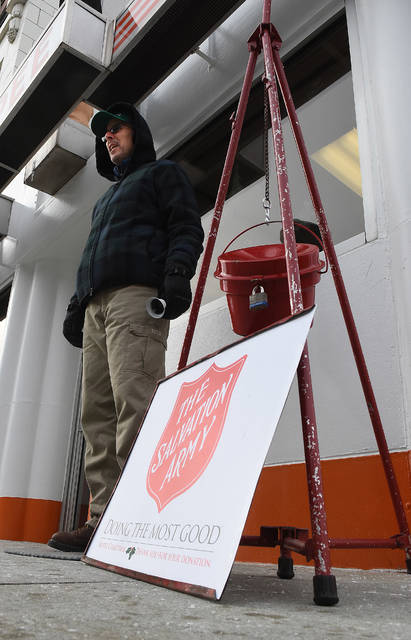 """Salvation Army volunteer, Rick Cheney of Lima, rings a bell while in front of Kewpee downtown on Tuesday. The Salvation Army is looking to reach the goal of $120,000. Cheney is retired and has volunteered for the Salvation Army for 15-years. """"It just makes me feel good and itճ a great organization,Ӡhe said. Craig J. Orosz 