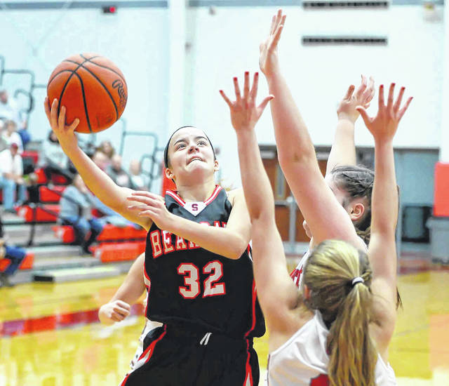 Spencerville's Emma Leis puts up a shot against Van Wert's Carly Smith during Monday's game at Van Wert High School.