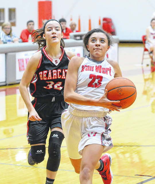 Van Wert's Caylee Phillips drives to the basket ahead of Spencerville's Emma Leis during Monday's game at Van Wert High School.