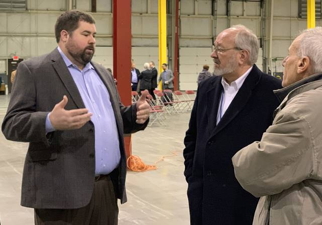 Andy Wannemacher, left, president of Wannemacher Total Logistics, talks about the company's spray drying operation move to Lima with David Berger, Lima's mayor, center, and Howard Elstro, the director of Lima's public works department.