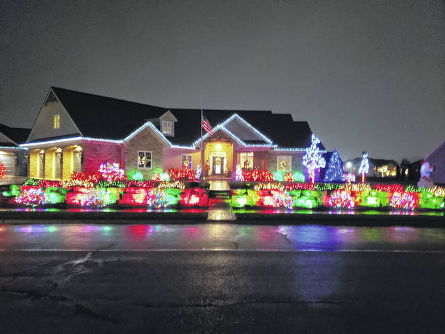 The Christmas light-covered home of the Bollenbachers, which won the Midwest Electric's 2018 Griswold Christmas Lights Contest, attracts looks from those driving down Dorothy Lane in St. Henry.