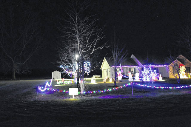 The home of Mark and Brenda Etter won the Paulding Putnam Electric Cooperative 2018 Griswold Christmas Lights Contest due to the efforts of their 18-year-old son Casey Etter.