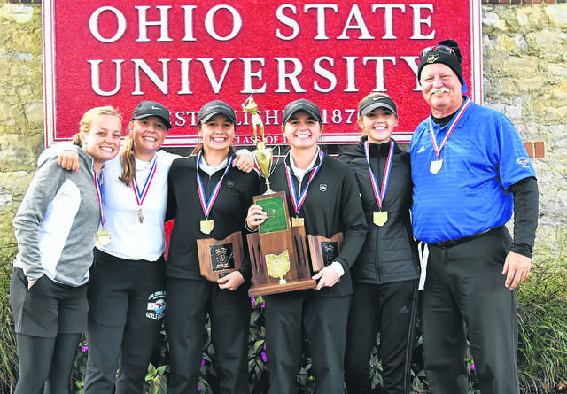 Lima Central Catholic's Meghan Mulcahy, left, Hannah Garver, Erin Mulcahy, Mary Kelly Mulcahy, Emma Mayers, and Coach Daniel Reinicke pose with the Division II state golf championship trophy.