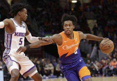 The Cavaliers' Collin Sexton drives to the basket against Sacramento's De'Aaron Fox during Friday night's game in Cleveland. (AP photo)