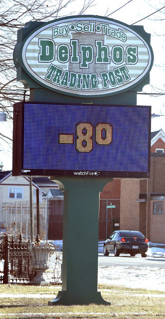 Delphos Trading Post electronic sign displays a frigid temperature of -8 degrees along Lincoln Highway in downtown Delphos on Wednesday.