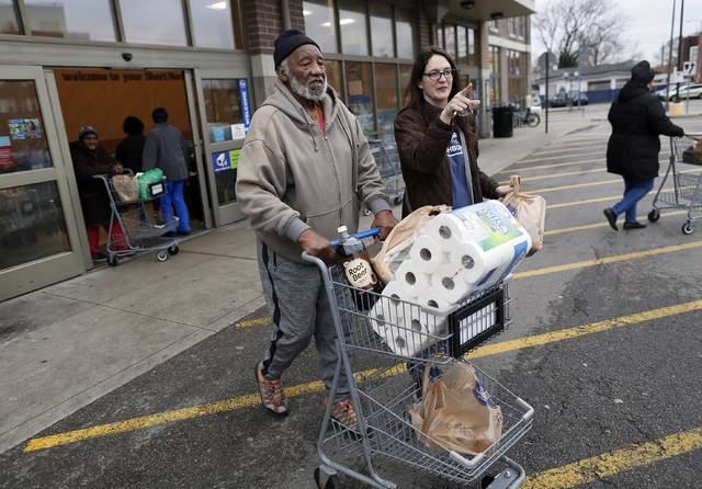 After picking him up at his Harrison West apartment, At Home by High executive director Katie Beaumont takes John Fuller, 84, to one of his twice-weekly grocery store trips on Dec. 21, 2018. In addition to grocery runs, Beaumont's business, which currently has 32 members all over the age of 50, provides services that include technology assistance, note-taking at medical appointments, and companion visits. [Adam Cairns/Dispatch]/The Columbus Dispatch via AP)