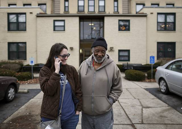 At Home by High executive director Katie Beaumont picks up John Fuller, 84, at his Harrison West apartment to take him to one of his twice-weekly grocery store trips on Dec. 21, 2018. In addition to grocery runs, Beaumont's business, which currently has 32 members all over the age of 50, provides services that include technology assistance, note-taking at medical appointments, and companion visits.  (Adam Cairns/The Columbus Dispatch via AP)