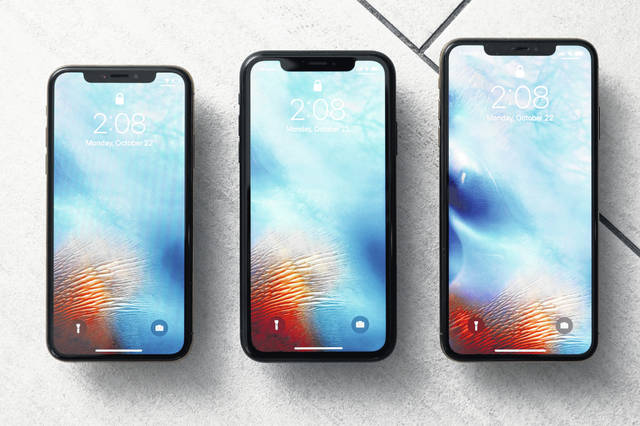 An iPhone XS, from left, iPhone XR and the iPhone XS Max can be seen in New York. Apple warns that disappointing iPhone sales will cause a significant drop in its revenue over the crucial holiday season compared to earlier projections. CEO Tim Cook made the announcement after the market closed Wednesday.