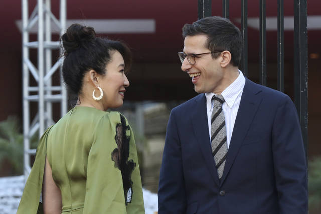 Sandra Oh, left, and Andy Samberg smile at each other after rolling out the red carpet at the 76th annual Golden Globe Awards Preview Day at The Beverly Hilton on Thursday, Jan. 3, 2019, in Beverly Hills, Calif. (Photo by Willy Sanjuan/Invision/AP)