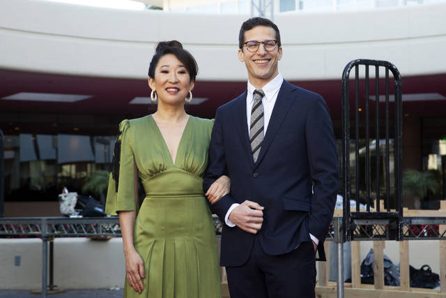 Sandra Oh, left, and Andy Samberg pose for a photo on the red carpet at the 76th Annual Golden Globe Awards Preview Day at The Beverly Hilton on Thursday, Jan. 3, 2019, in Beverly Hills, Calif. (Photo by Willy Sanjuan/Invision/AP)
