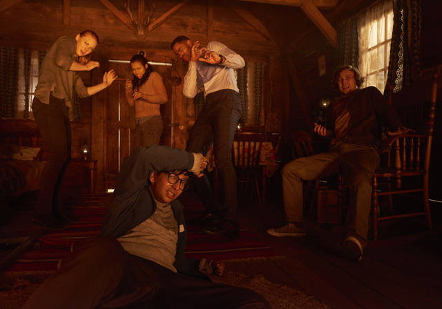 "This image released by Sony Pictures shows Deborah Ann Woll, clockwise from left, Taylor Russell, Jay Ellis, Logan Miller and Nick Dodani in ""Escape Room."" (David Bloom/Sony Pictures via AP)"