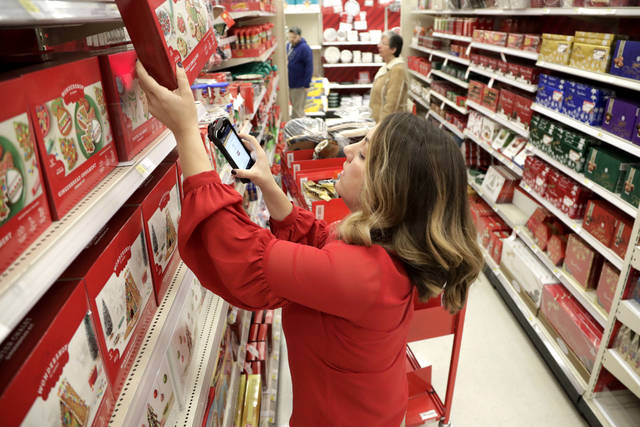 FILE- In this Nov. 16, 2018, file photo Target employee Lindsay Walker scans an item as she collects merchandise from shelves to prep them for an online order at a Target store in Edison, N.J. On Monday, Jan. 7, 2019, the Institute for Supply Management, a trade group of purchasing managers, issues its index of non-manufacturing activity for December. (AP Photo/Julio Cortez, File)