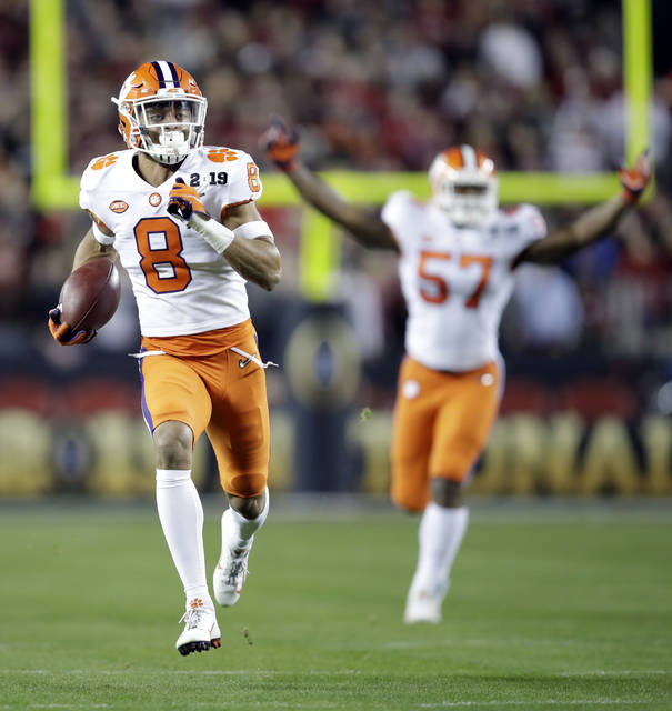 Clemson's A.J. Terrell intercepts a pass for a touchdown during the first half the NCAA college football playoff championship game against Alabama, Monday in Santa Clara, Calif.