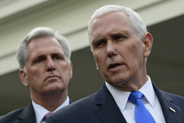Vice President Mike Pence, right, standing with House Minority Leader Kevin McCarthy of Calif., left, speaks to reporters following a meeting with President Donald Trump and Democratic congressional leaders at the White House in Washington, Wednesday, Jan. 9, 2019. (AP Photo/Susan Walsh)