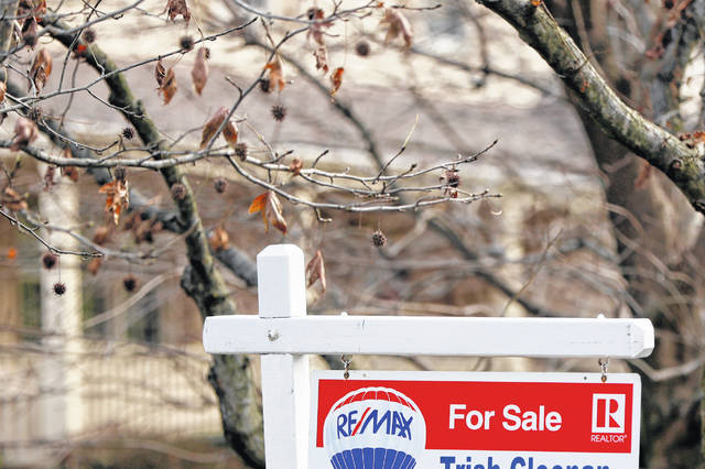 A realtor sign marks a home for sale Jan. 3 in Franklin Park, Pa. The partial federal government shutdown is complicating the already complicated process of getting and managing a mortgage. For one thing, the political storm is like severe weather at a major airport: You can expect minor delays or worse. Also, it could mean financial hardship for some federal government employees facing mortgage payments without their regular paychecks.