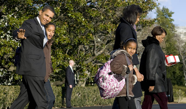 FILE - In this Friday, Feb. 13, 2009 file photo, President Barack Obama and family, depart from the South Lawn of the White House in Washington, for Andrews Air Force Base before heading to Chicago. From left are, the president, his daughter Malia, daughter Sasha, first lady Michelle Obama, and his mother-in-law Marian Robinson. On Friday, Jan. 11, 2018, The Associated Press has found that stories circulating on the internet that Robinson will receive a $160,000 lifetime government pension, are untrue. (AP Photo/Evan Vucci)
