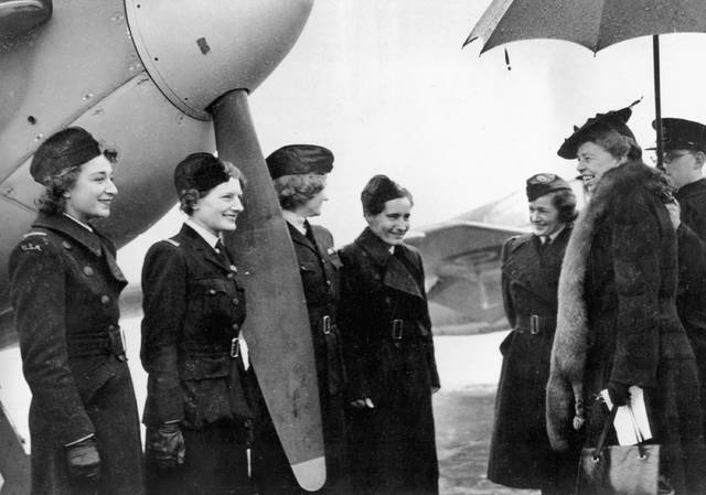 FILE - In this Oct. 1942 file photo, U.S. first lady Eleanor Roosevelt, right, talks with American women ferry pilots serving with the Air Transport Auxiliary at an airfield in England during World War II. On Friday, Jan. 11, 2018, The Associated Press has found that stories circulating on the internet that Melania Trump was the first first lady to visit a combat zone since 1969, are untrue. (AP Photo/File)