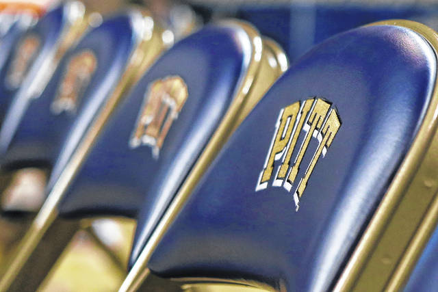 """A row of chairs with the """"Pitt"""" logo can be seen at a University of Pittsburgh NCAA college basketball game in Pittsburgh. Pitt is offering graduating seniors up to $5,000 in federal student loan relief with one request: They pay it forward."""