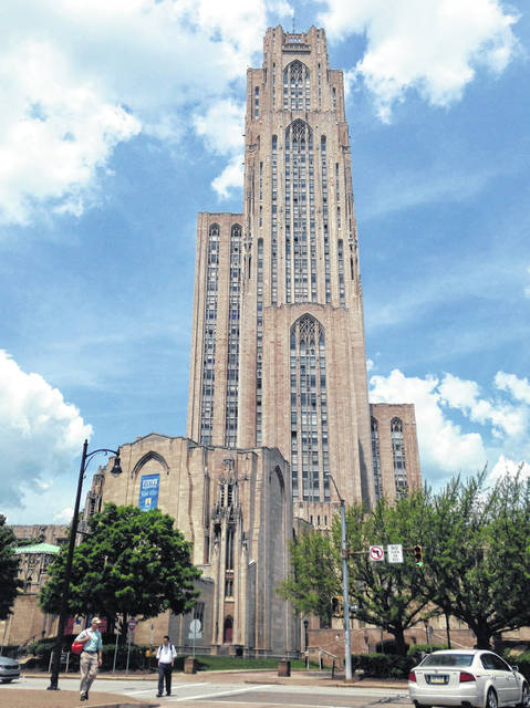 The Cathedral of Learning, a landmark listed in the National Register of Historic Places, stands on the University of Pittsburgh's main campus in Pittsburgh. The school's new program, Panthers Forward, will help recent graduates chip away at student debt and introduce them to alumni mentors to encourage professional development.