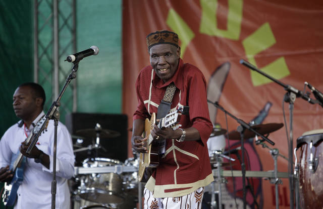 FILE - In this Sunday, Nov. 6, 2011 file photo, Zimbabwean music superstar and U.N. goodwill ambassador Oliver Mtukudzi, center, performs at a music festival held in Karen on the outskirts of Nairobi, Kenya. Zimbabwean musician and world music star Oliver Mtukudzi dies in Harare at age 66, it was announced Wednesday.