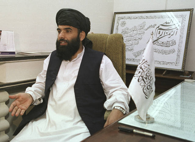 FILE - In this Nov. 14, 2001 file photo, Suhail Shaheen, then Deputy ambassador of the Islamic Republic of Afghanistan, gives an interview in Islamabad, Pakistan. Shaheen, a spokesman for the Taliban said Wednesday, Jan. 30, 2019, that they are not seeking a monopoly on power in a future administration in Afghanistan but are looking for ways to co-exist with Afghan institutions. The comments were provided to The Associated Press in an audio message from Qatar. (AP Photo/Tariq Aziz)