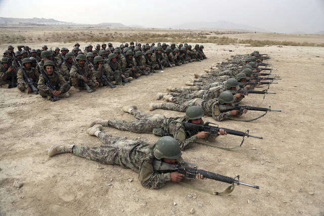 FILE - In this Oct. 31, 2018, photo, Afghan National Army (ANA) soldiers carry out an exercise during a live firing at the Afghan Military Academy in Kabul, Afghanistan. Trump administration claims of progress in talks with the Taliban have sparked fears even among allies of the president that his impatience with the war in Afghanistan will lead him to withdraw troops too soon, leaving the country at risk of returning to the same volatile condition that prompted the invasion in the first place. (AP Photo/Rahmat Gul, File)