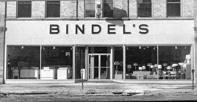 "This photo published in the Lima Citizen in 1957 shows the new and modernized front of the remodeled and enlarged Bindel's store at 212 S. Main St. ""The 50-foot glass, aluminum and porcelain front is designed to improve visibility of the store's interior from the street and sidewalk. In addition to the changes made by the remodeling, Louis Bindel, owner, has added a complete line of furniture to the appliance items which the store has handled during the nine-years-plus that it has been in business."""