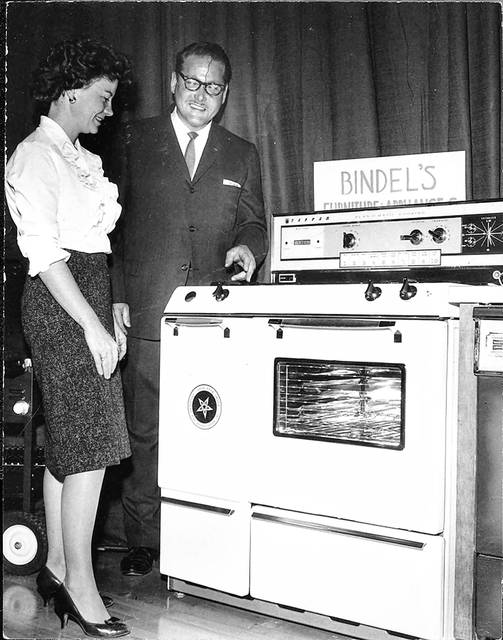 This photo from 1963 shows Janet (Mrs. Stanley R.) Bogdan, of Cridersville, with Lou Bindel of Bindel's Appliances and the new Tappan range she won in the final session of the West Ohio Gas 1963 cooking school.