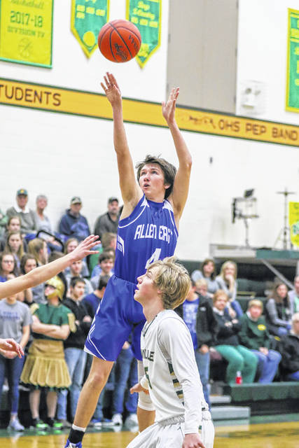 Allen East's Logan McCluer puts up a shot against Ottoville's Jaden Schnipke during Tuesday night's game at Ottoville.