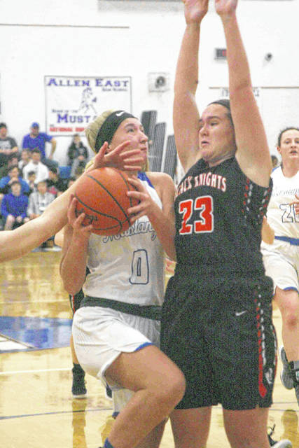 Allen East's Tori Newland goes up strong against Van Buren's Zoe Horne in a non league game Monday.