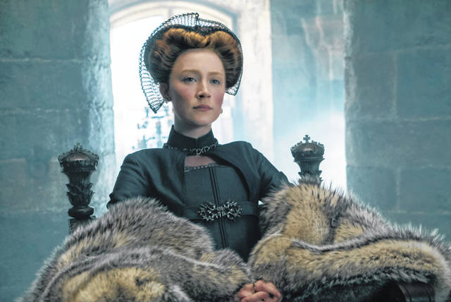 "This image released by Focus Features shows Saoirse Ronan as Mary Stuart in a scene from ""Mary Queen of Scots."""