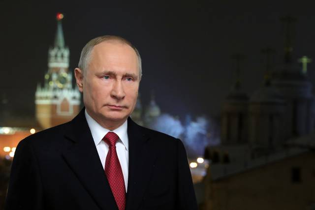 "In this photo released by Kremlin Press service via Sputnik agency, Russian President Vladimir Putin speaks during a recording of his annual televised New Year's message in the Kremlin in Moscow, Russia, Monday, Jan. 31, 2018. In a televised address just before midnight, Putin said that ""we can achieve positive results only through our own efforts and well-coordinated teamwork."" (Mikhail Klimentyev, Sputnik, Kremlin Pool Photo via AP)"