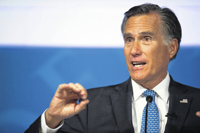 """File-This Oct. 9, 2018, file photo shows Republican U.S. Senate candidate Mitt Romney answering a question about tariffs during the debate with Democratic opponent Jenny Wilson in the America First Event Center in Cedar City, Utah. Utah Sen.-elect Romney says President Donald Trump's """"conduct over the past two years … is evidence that the president has not risen to the mantle of the office."""" Romney, who was the Republican presidential nominee in 2012, is praising some of Trump's policy decisions in a Washington Post op-ed published Tuesday, Jan. 1, 2019."""