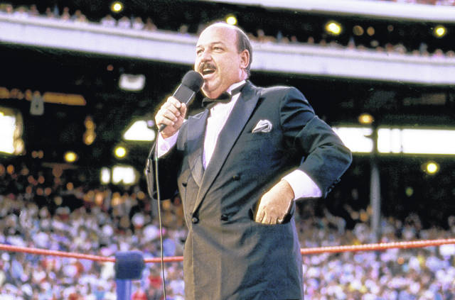 """Mean"" Gene Okerlund addresses the crowd in 1988 before a pro wrestling event in Milwaukee. Okerlund, who interviewed pro wrestling superstars ""Macho Man"" Randy Savage, The Ultimate Warrior and Hulk Hogan, died at the age of 76."