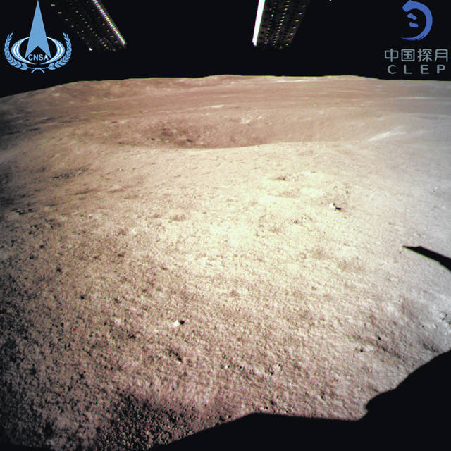 In this photo provided Jan. 3, 2019, by China National Space Administration via Xinhua News Agency, the first image of the moon's far side taken by China's Chang'e-4 probe. A Chinese spacecraft on Thursday, Jan. 3, made the first-ever landing on the far side of the moon, state media said. The lunar explorer Chang'e 4 touched down at 10:26 a.m., China Central Television said in a brief announcement at the top of its noon news broadcast.