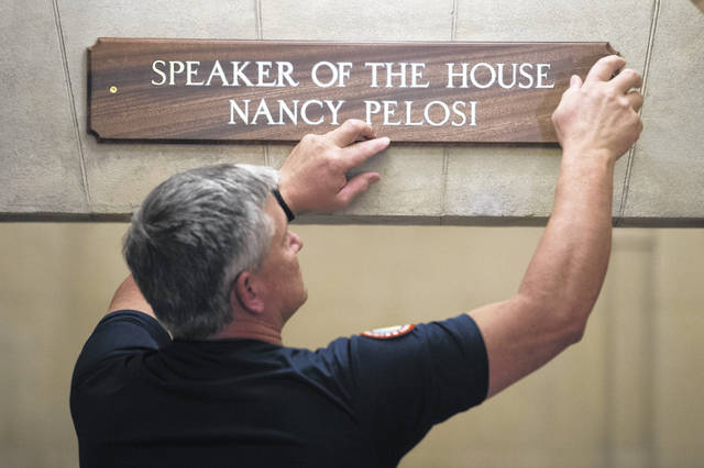 The sign at the office suite of House Speaker Nancy Pelosi of Calif., is installed on Capitol Hill in Washington, Thursday, Jan. 3, 2019, during the opening session of the 116th Congress.