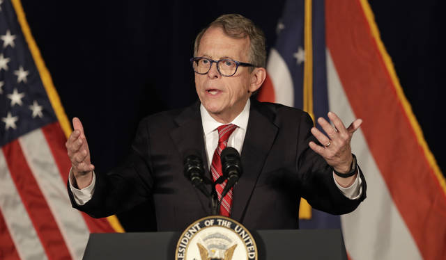 FILE - In this Oct. 31, 2018, file photo, Mike DeWine, Republican candidate for Ohio Governor, speaks at the Mansfield Lahm Regional Airport in Mansfield. After a swearing-in ceremony at midnight in Cedarville, DeWine will be sworn in publicly at noon at a ceremony at the Ohio Statehouse.