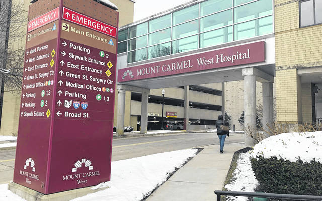 """The main entrance to Mount Carmel West Hospital is shown Tuesday, Jan. 15, 2019. An intensive care doctor ordered """"significantly excessive and potentially fatal"""" doses of pain medicine for over two dozen near-death patients in the past few years after families asked that lifesaving measures be stopped, an Ohio hospital system announced after being sued by a family alleging a dose of fentanyl hastened a woman's death. The Columbus-area Mount Carmel Health System said it fired the doctor, reported its findings to authorities and removed multiple employees from patient care pending further investigation, including nurses who administered the medication and pharmacists."""