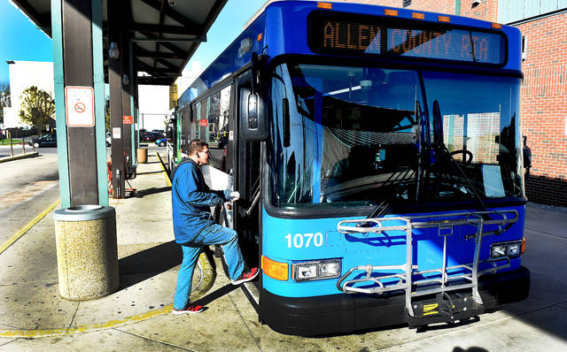 A passenger sets into a RTA bus at the Allen County RTA bus terminal in downtown Lima. Craig J. Orosz | The Lima News