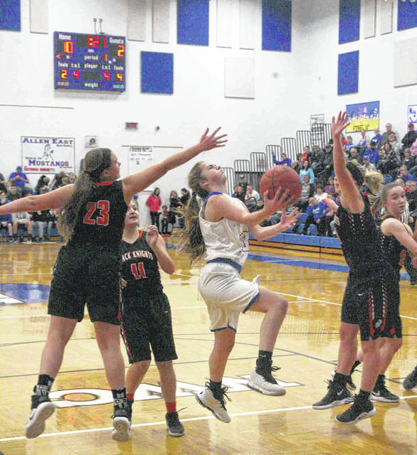 Allen East's Ally Richardson splits the Van Buren defense as she lays one in for the Mustangs in a nonleague affair Monday.