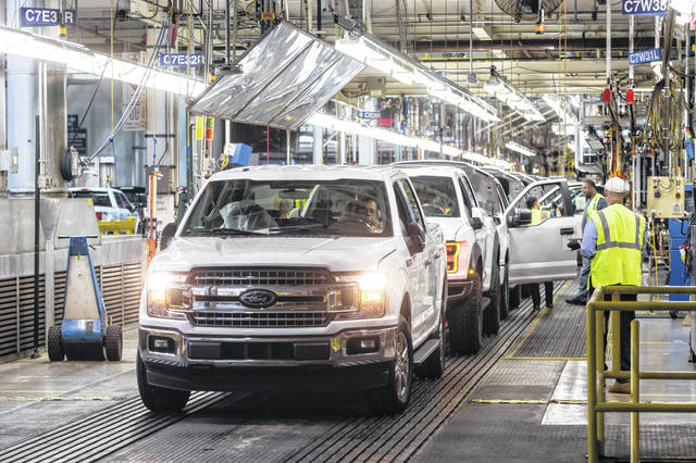 "Ford F-150 trucks come off the assembly line at the Ford Rouge Plant in Dearborn in September. ""We're going to electrify the F-Series,"" Jim Farley, Ford president of global markets, said this week."