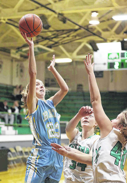 Bath's Ruby Bolon puts up a shot against Celina's Maddy Luebke, center, and Emma Homan (40) during Thursday night's Western Buckeye League game at Celina's Fieldhouse.